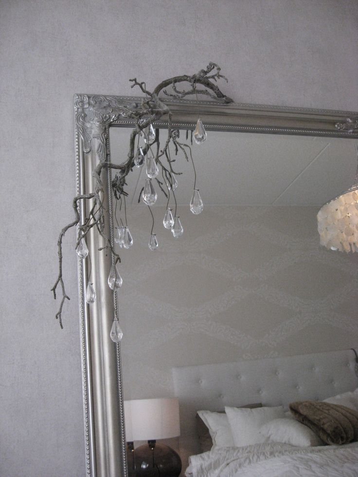 White, gray and brown bedroom, silver frame mirror