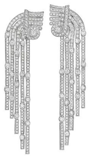 Cartier. A Pair of Diamond Ear Pendants. Each designed as a gradutated series of highly flexible pavé-set diamond links, interspersed with collet-set circular-cut diamonds, to the geometric motif circular-cut diamond surmount, mounted in 18K white gold, length 3 inches. Signed 'Cartier', no.D4215, with French assay marks. Philips de Pury.
