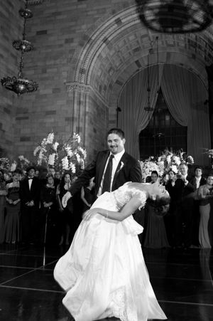Groom Dips Bride In Dance