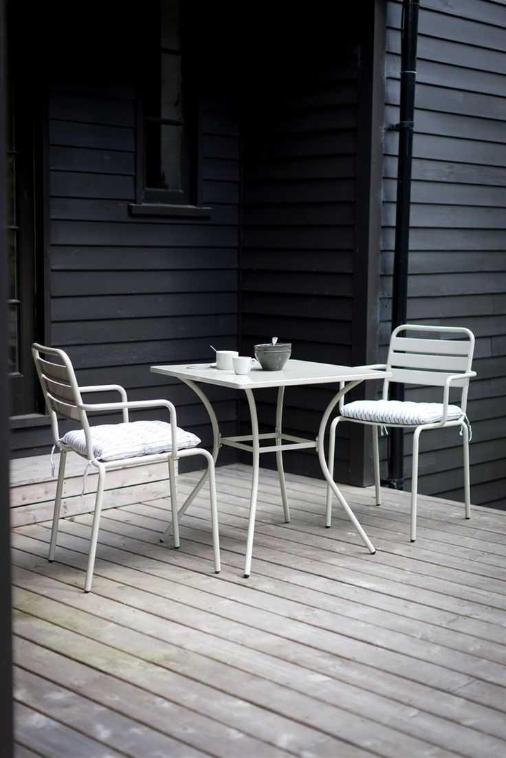 A durable outdoor table and chair set, perfect for alfresco dining