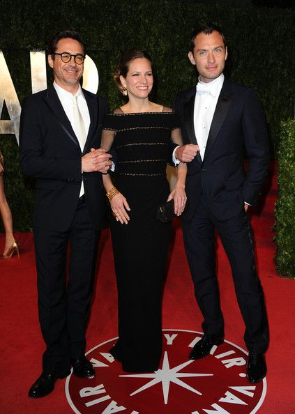 Robert Downey Jr. Photos - Actor  Robert Downey Jr with wife Susan Downey and Actor Jude Law arrive at the Vanity Fair Oscar party hosted by Graydon Carter held at Sunset Tower on February 27, 2011 in West Hollywood, California. - 2011 Vanity Fair Oscar Party Hosted By Graydon Carter - Arrivals