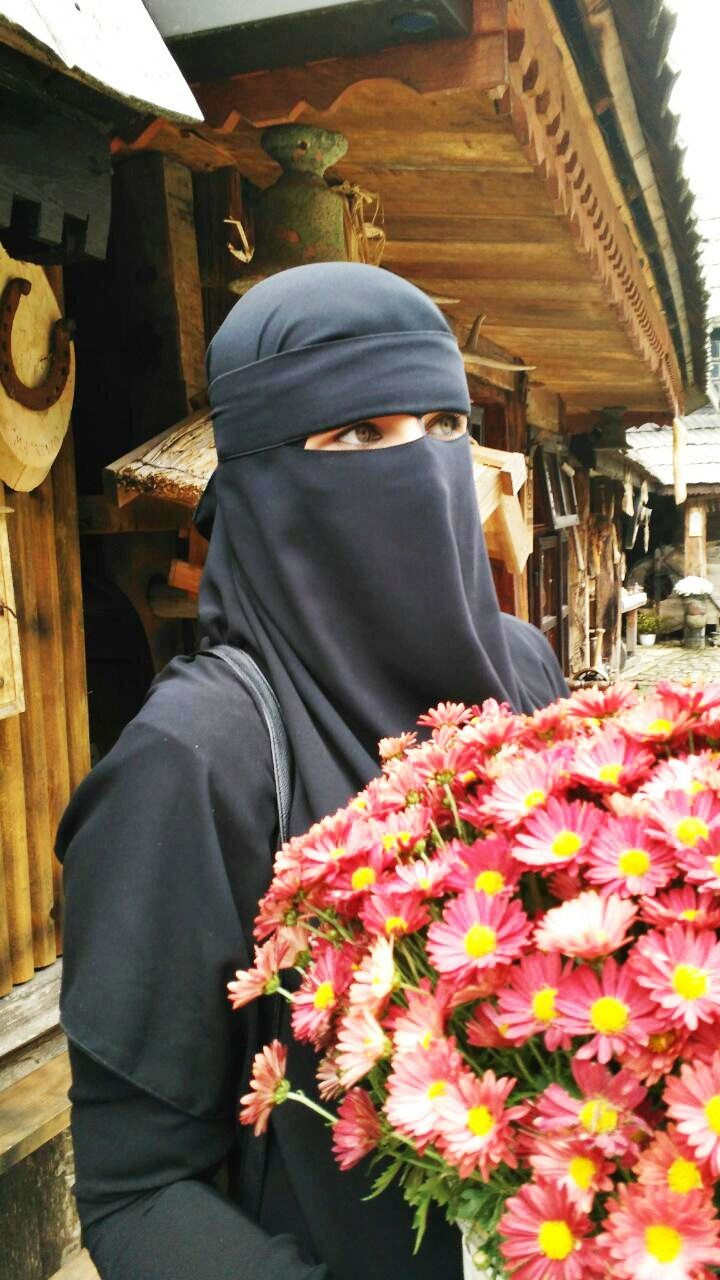 Muslimah and Red Daisies