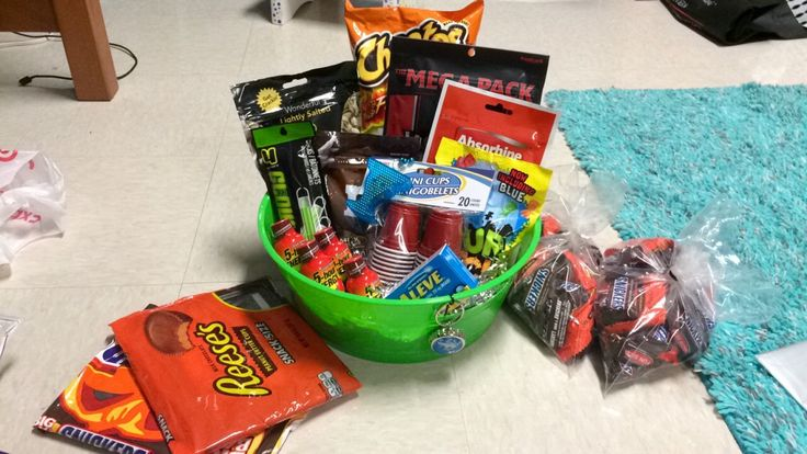 Not finished product but it's A 21st birthday gift for my boyfriend. Snacks, random things, medicine (for hangover), and money for beer cus you can't mail alcohol. I also have 2 framed pictures of us wrapped in the candy bags.