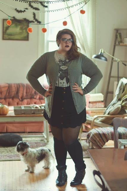 Quirky, retro, witchy style. Plus-size, curvy outfit. Cardigan, graphic tee, suede skirt, over the knee socks, boots. The Classy Junk