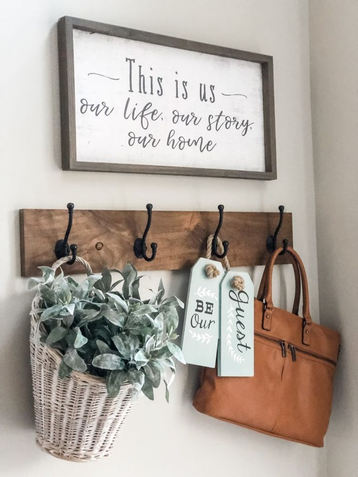 Easy entry way decorating ideas using a storage bench, hooks and decor!