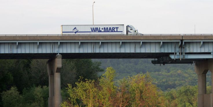 A Wal-Mart truck passes over the Susquehanna River on Interstate 81 in Harrisburg, Pa., in this May 9, 2006 file photo.