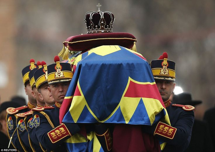 Honor guard soldiers carry the coffin of the late Romanian King Michael during the funeral...