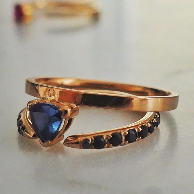 ADAMS PEAK  Dark blue trillion cut sapphire on 14-karat gold    THE SNAKE TAIL  Petite black sapphires on an open 14-karat gold   #ring  #NANGI #beNANGI #finejewelry #jewelry #sapphire #gold #trillion #snaketail #AdamsPeak
