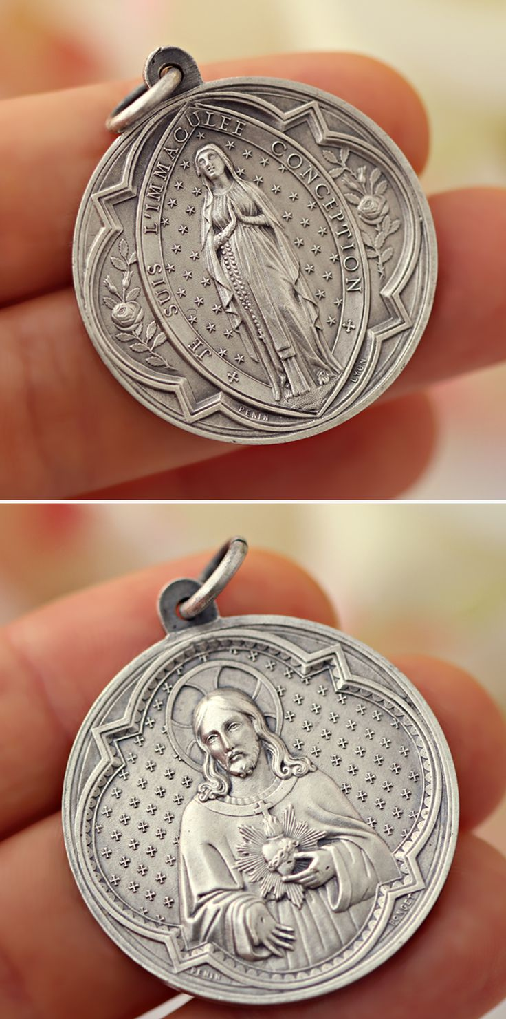 "Rare French medal of the apparition of Our Lady of Lourdes surrounded by the text in French: ""JE SUIS L'IMMACULEE CONCEPTION"". Many details ornaments around The Virgin Mary. On the back of the medal, we can discover the Sacred Heart of our Lord Jesus Christ.   #rosary #handmade #made #in #France #vintage #old #lourdes #virgin #mary #our #lady #cross #crucifix #catholic #jewelry  #jesus #christ #religious #christian #rosaries #etsy #french #art #deco #silver #bronze #immaculate #heart #sacred"