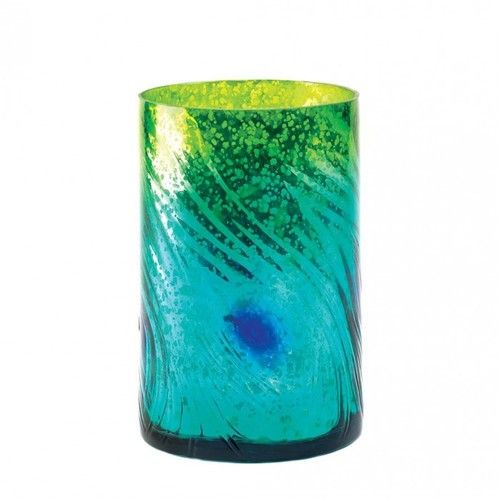 The colors of the swirling Mediterranean tide are captured in this vases entrancing details. The subtle texture of a swift current and bubbling mixture of greens, blues and golds make this a standout centerpiece.  Use this gorgeous vase as a candleholder, fill it with glass stones, or place on your dining table for a simply dramatic centerpiece. Candle not included.