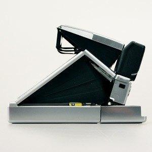 SX-70 Sonar Onestep Silver Camera.  Folds FLAT when not in use.