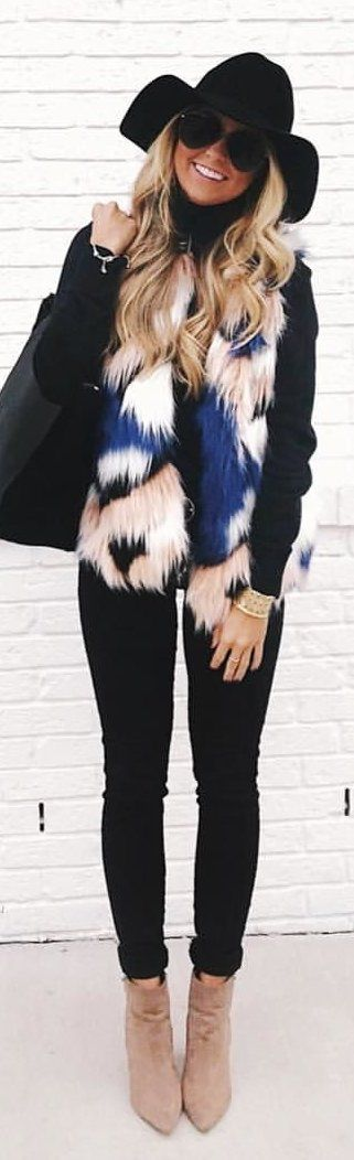 #winter #outfits black long-sleeved shirt, black pants, blue and white fur,vest, and brown leather boots outfit