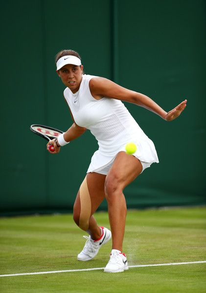 Madison Keys Photos Photos - Madison Keys of the United States plays a forehand during the Ladies Singles first round match on day one of the Wimbledon Lawn Tennis Championships at the All England Lawn Tennis and Croquet Club on July 3, 2017 in London, England. - Day One: The Championships - Wimbledon 2017