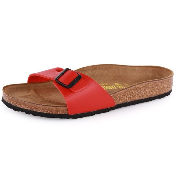 Red Birkenstock Sandals Birkenstock Madrid in Red leather (not patent). Good, used condition. Size W5 / EUR 35 - I am usually a size 6, and also a 6/EUR36 on the Arizona model. Wear on sole of outer heel. Buckle is scuffed, minimal cork cracking. Footbed intact. Tons of life left!  This classic with a cork midsole for premium comfort boasts a slender slide strap in high-gloss synthetic for a festive finish. A grippy outsole ensures you frolic with ease wherever the sun takes you in…