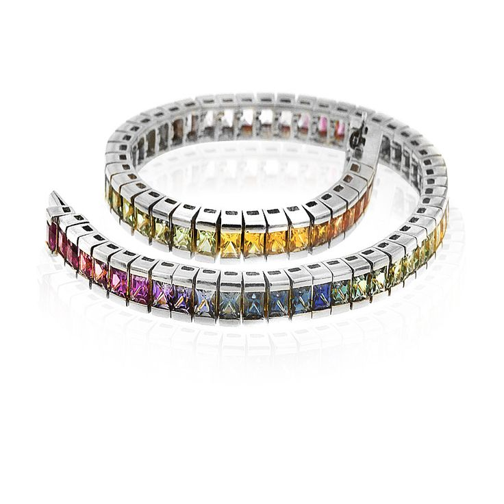 Colour your world with this vibrant Kaleidoscope sapphire bracelet incorporating varying shades of blue, green, pink, yellow and orange gemstones. Crafted in 18ct white gold. Length 19cm. Width 4mm.