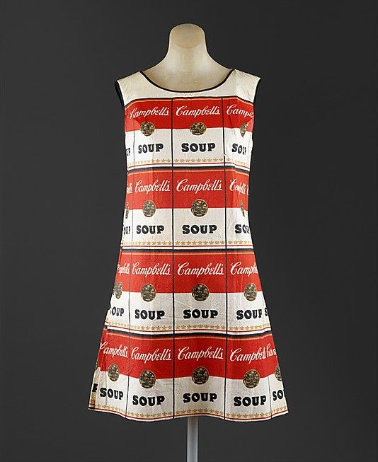 """This iconic dress is called """"The Souper Dress."""" It was made in 1966-1967. It was inspired by pop art. """"Pop art featured glorified representations of ordinary objects such as soda cans and cartoon figures."""""""