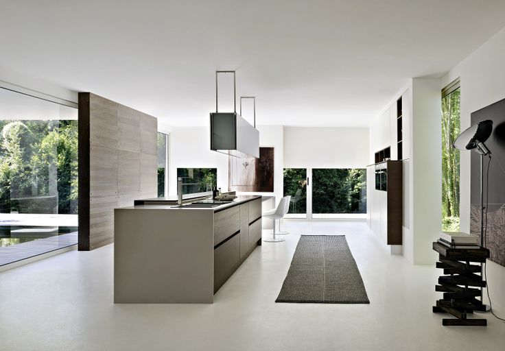 Combination of matte white lacquer, with rift-cut oak in a medium stain. The style and finishes of the modern kitchen compliment the modern architecture.