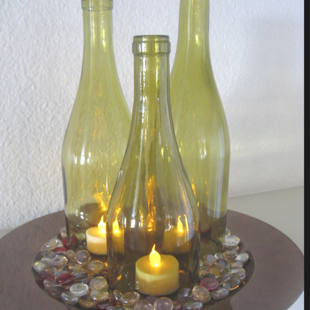 1000 images about wine bottle center pieces on pinterest for Wine bottle wedding centerpieces