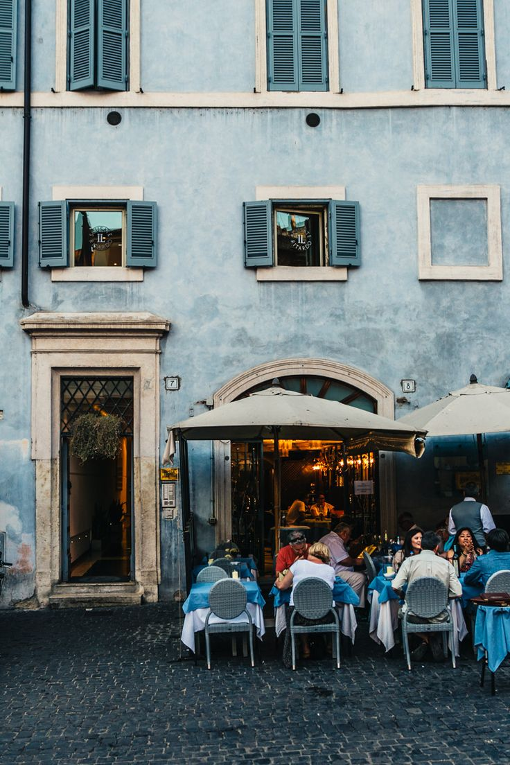 Relaxed outdoor dining at a charming eatery in Rome, Italy.