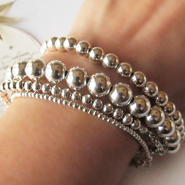 A stunning Silver Bead Bracelet Set of 4 available to buy on my new website Nikki Hills Design https://nikkihillsdesign.com/ Remember to claim your 20% discount by signing up to my VIP Email club. Enjoy complimentary first class shipping within the US and flat rate international shipping. Silver Bead Bracelets Gift for Her Stacked Bracelets Layered Bracelets Sterling Silver 925 Silver Bracelets #nikkihillsdesign