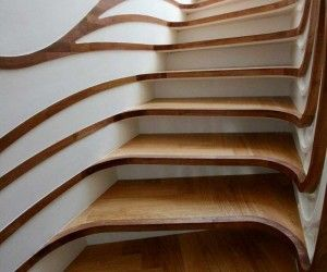 Stylish Curved Staircase With Organic Form.