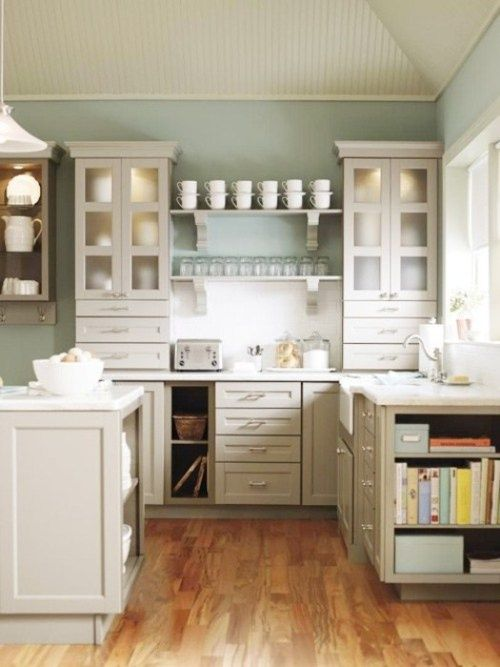 White Or Pale Gray Kitchen With Robins Egg Blue Walls Open Shelving And Cabinets Frosted Glass Doors Warm Wood Floors Keep The Space From Feeling