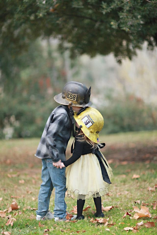 I just loved this sweet moment. Their daddy is a firefighter and they got to wear his old helmets. So sweet.    www.brookealiceon.com