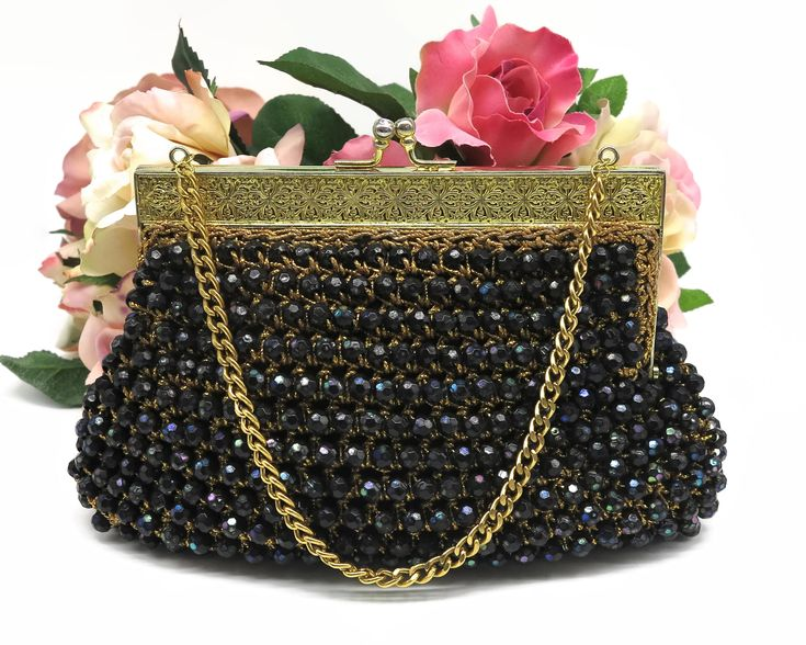 Mid century black beaded handbag with large iridescent beads crocheted into gold metallic thread, gold filigree frame, rhinestone kiss lock by CardCurios on Etsy