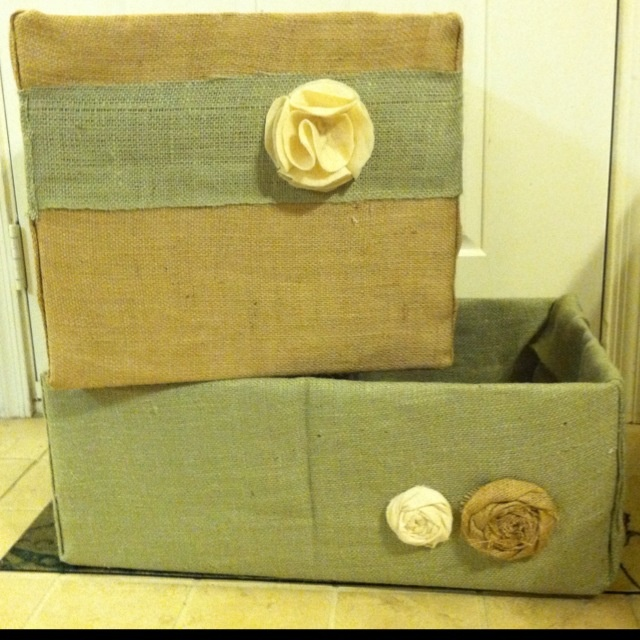 Re-purposed nursery toy boxes out of used diaper boxes.    Materials: Burlap, felt, diaper boxes, paper, and glue gun. *HINT: I wrapped the boxes in upside down wrapping paper first, as burlap is slightly see-through.