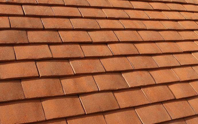 Clay is a natural, durable and beautiful roofing material. It has been used to make roof tiles in England for over 800 years and even today clay tiles are still the first choice to cover a roof. And that's because of their durability, efficiency and traditional look.