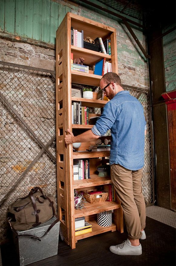 Smart Bookcase Features a Ladder That Pulls Out Immediately by Alejandro Sticotti.