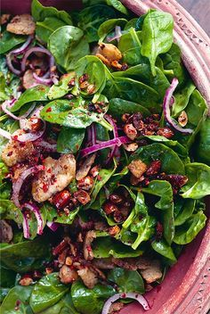 Ottolenghi's Spinach salad with dates & almonds.