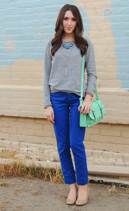 Fall/ winter outfit ideas. Grey sweater. Cobalt blue pants/ statement necklace. Mint bag. Layered Brights. Nude pumps.