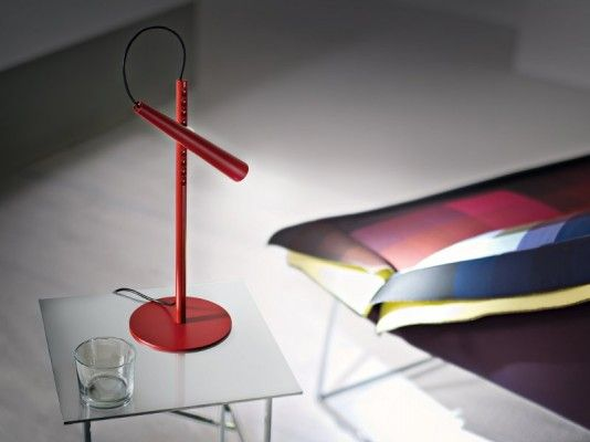 Magneto lamp - the ball is magnet that enables light to angle in any direction. By Foscarini