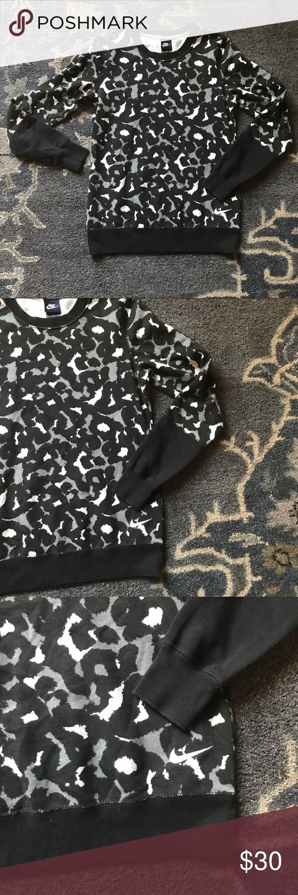 Nike Leopard Pullover Sweatshirt Body:  80% cotton 20% polyester  Rib: 100% cotton  Length: 27 in Armpit to armpit: 20 in Nike Jackets & Coats