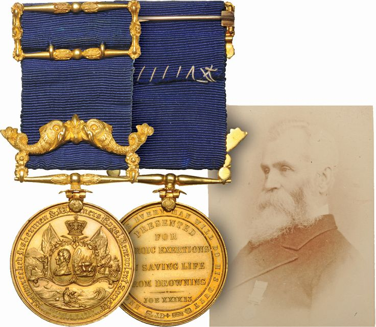 """Great Britain Shipwrecked Fishermen and Mariners Royal Benevolent Society 36mm x 22 ct. gold medal with dolphin suspender and similarly ornate gold riband brooch apparently designed to match, engraved to """"Captain Wm.Morrison 1859"""" in contemporary presentation case incorporating an original photograph of the recipient wearing the award, a couple of edge scuffs but virtually As Struck"""