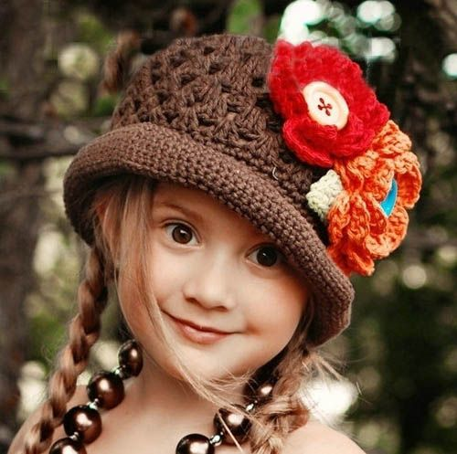 Crochet Hat with Flowers - Brown Nat or Hannah would love this.... If only I knew how to crochet!