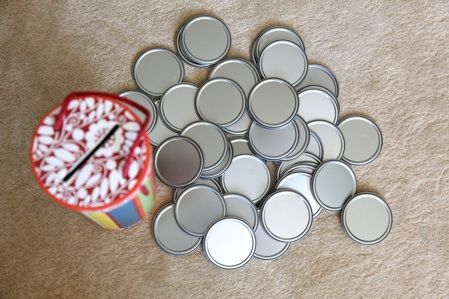 lid toy- uses a wine gifting tube and the metal lids from juice cans. perfect toy for toddlers who still put things in mouth