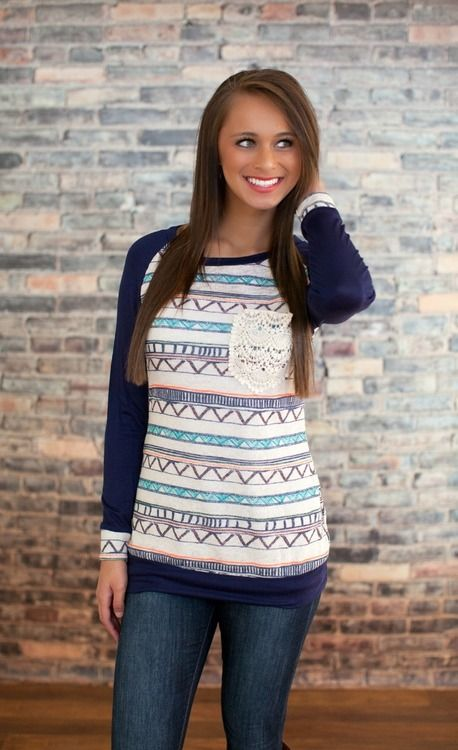 Classic baseball tee meets trendy southwest inspired Aztec design in this must have tunic. Complete with the cutest front lace pocket.