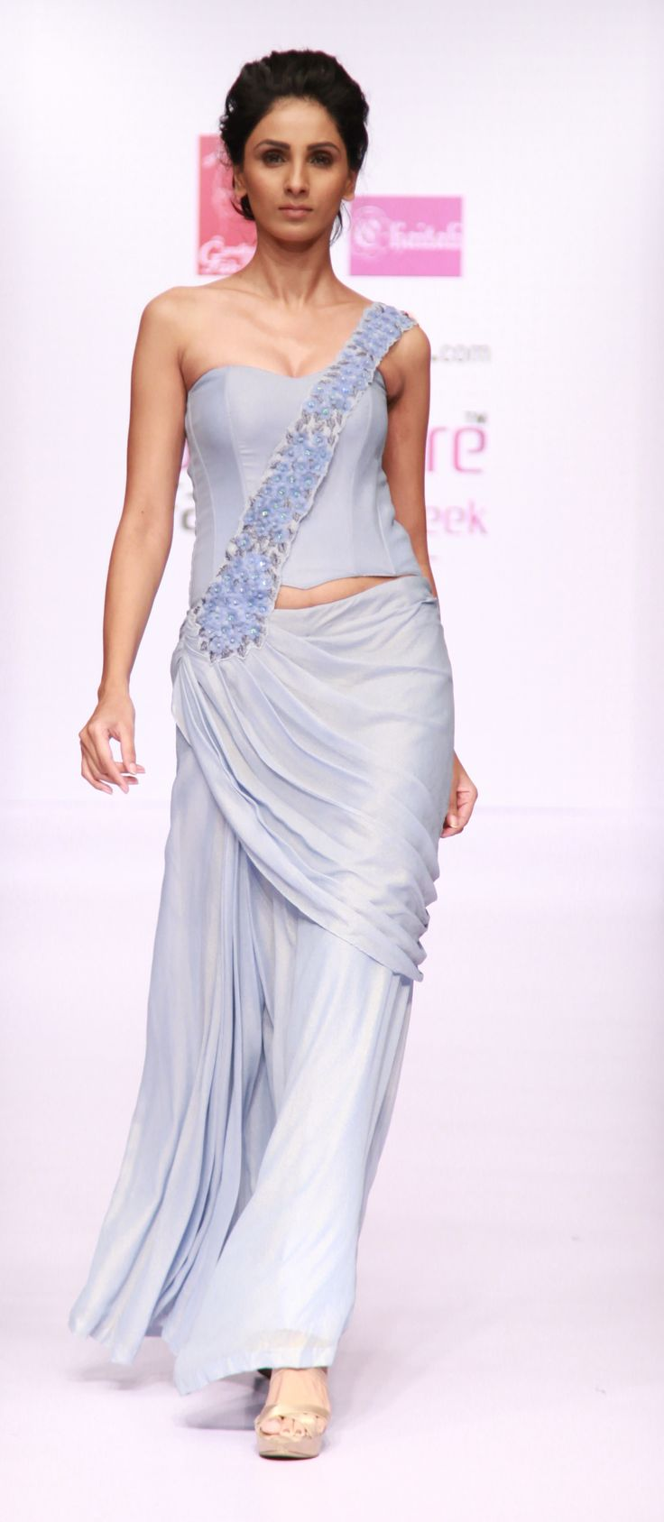 powder blue shimmer georgette ready to wear saree with embellishment of flowers and metallic threads along with sensual corset by Chaitali Jhunjhunwala
