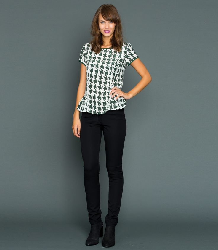 Boasting an frilled hem, the Houndstooth Frill Tee features a flattering scooped neckline, capped sleeves and a 100% Silk fabrication. Incredibly versatile, is best styled over skinny denim or teamed with shorts for an effortlessly styled look.  Model is 5'11 and wears a size 8