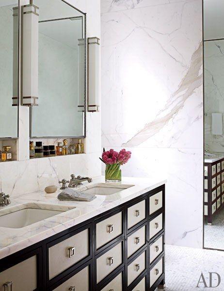 A master bath clad in Calacatta gold marble | archdigest.com