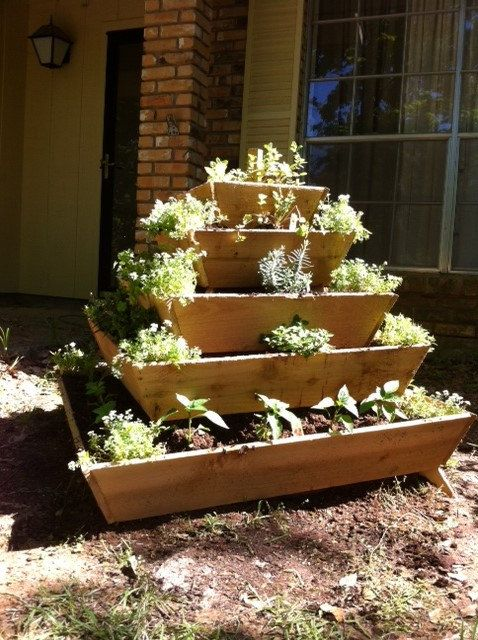 Pyramid Planter. Saves space and still looks cute