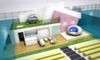 The centrepiece of this year's Ideal Home Show has been unveiled as a gizmo-laden, grass-roofed property submerged in an Olympic-sized swimming pool.
