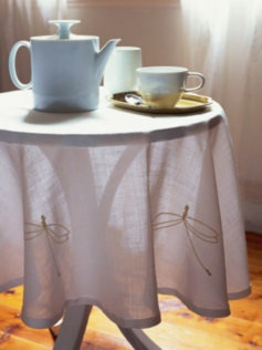 Dragonflies on a tablecloth.  Sweet!