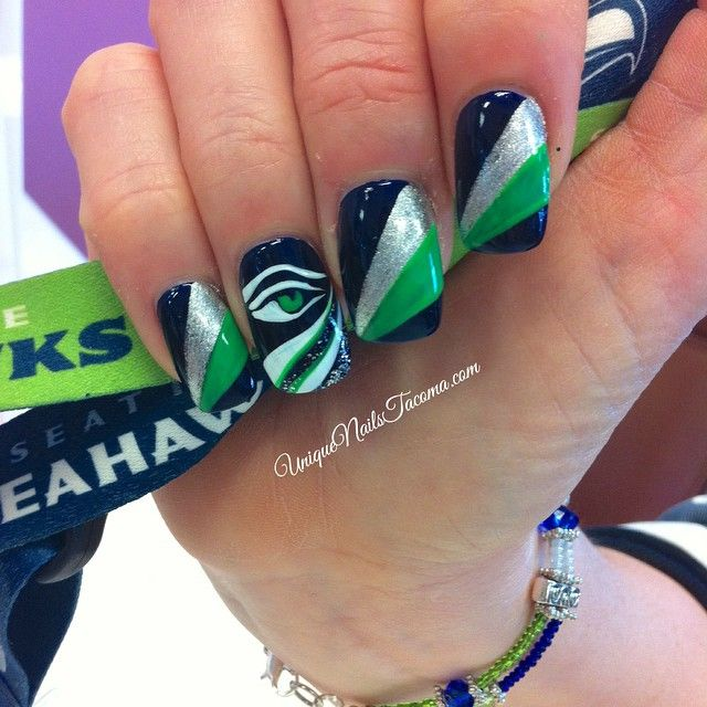 I love everything about this Seahawks nail design by Unique Nails Tacoma! The shimmery silver nail polish & hand painted seahawk eye really make this Hawks mani stand out. #seahawks #superbowl #nailart #manicure