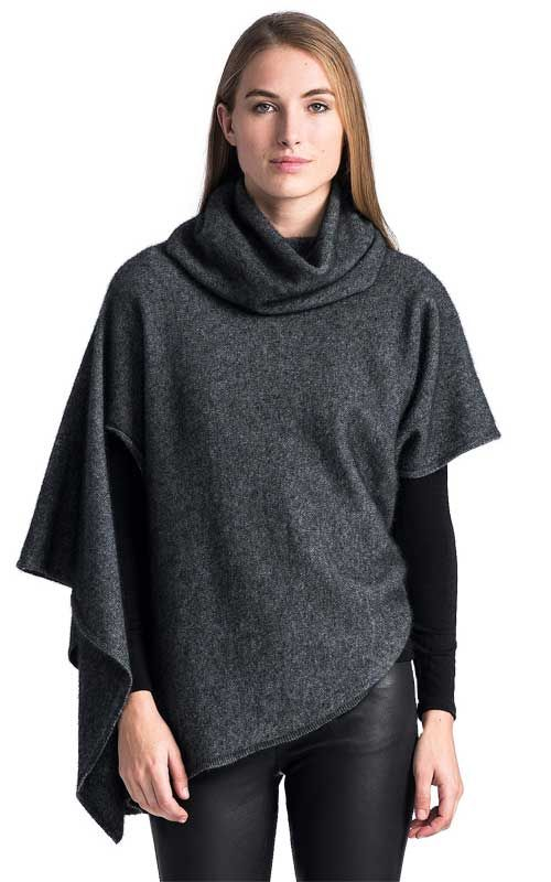 This interesting relaxed fit asymmetrical cape-style sweater from Untouched World has a relaxed cowl neck for extra warmth and a stylish effect.  Made from our super warm Ecopossum blend of Merino, Possum and Silk, wear it with a pair of leggings or jeans and pull on a pair of winter boots and you'll be cosy on the coldest of winter days.