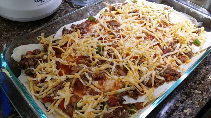 """Dolly Parton"" Mexican Lasagna  Ingredients  1 lb ground beef 1 container of mushrooms, chopped 1 green bell pepper, chopped 1 medium onion, chopped 1 jar spaghetti sauce 1 can rotel 1 pack of tortillas 4oz Colby Jack cheese, shredded 4oz Cheddar Cheese, shredded"