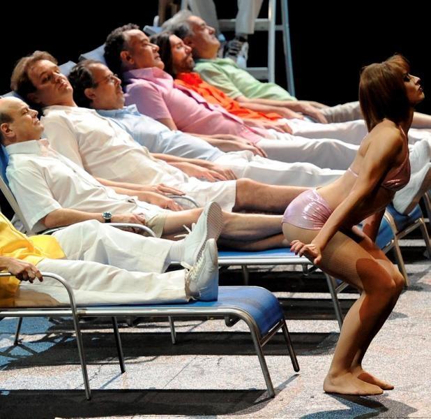 Theatre du Capitole Toulouse- men lounging in preppy resort clothes, women dive into pool w/ splash sounds