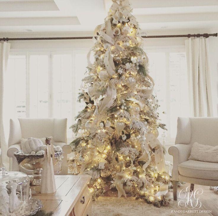 White flocked Christmas tree with mercury glass